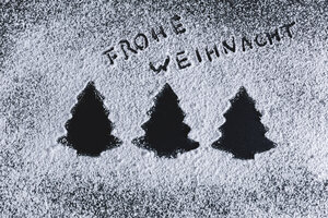 Icing sugar on black background, fir trees, merry christmas - STBF00248