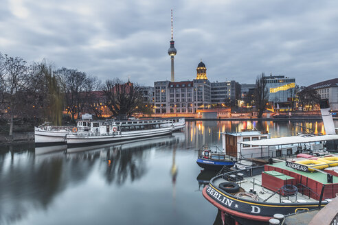 Germany, Berlin-Mitte, Historical harbour, Spree river in the evening, Berlin TV Tower in the background - KEB01215