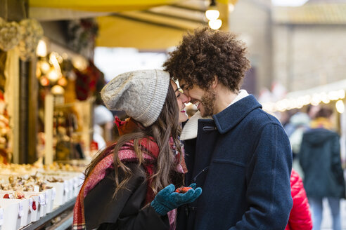 Italy, Tuscany, Florence, Young Couple at the Christmas Market - MGIF00304