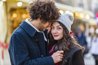 Happy affectionate young couple at Christmas market - MGIF00313