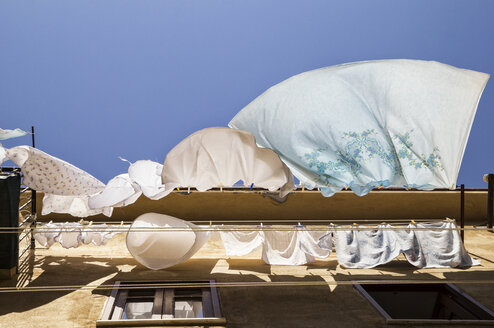 Sicily, Cefalu, drying laundry, wind, low angle view - MAMF00463