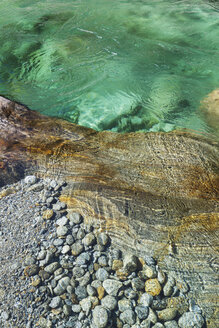 Switzerland, Ticino, Verzasca Valley, stones and rocks in clear turquoise waters of Verzasca river - GWF05953