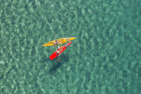 Drone shot of couple kayaking together in sea - CAVF62407