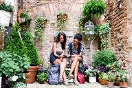 Friends enjoying peaceful corner with plants, Città della Pieve, Umbria, Italy - CUF49474
