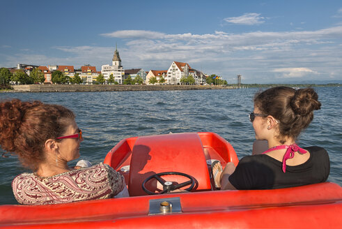 Lake Constance, Mother and daughter in a pedal boat, Friedrichshafen in the background - SH02063