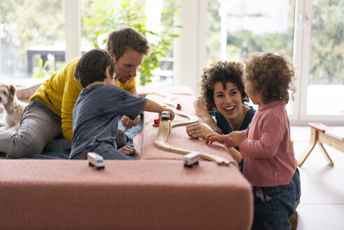 Happy family playing with their kids on a weekend - JOSF03085