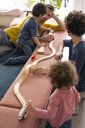 Happy family playing with their kids on a weekend - JOSF03091