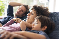 Family sitting on couch - JOSF03127