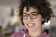 Portrait of a young woman with curly hair, wearing glasses - JOSF03130