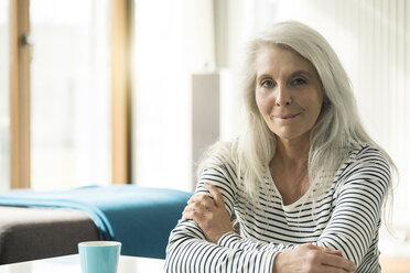 Portrait of mature woman at home - SBOF01847