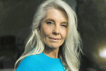 Portrait of content mature woman wearing blue pullover - SBOF01853