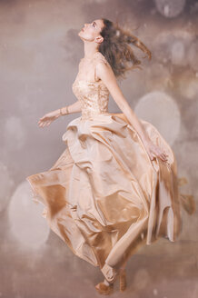 Young woman wearing nude-colored evening dress - FCF01705