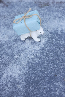 Toy ice bear carrying Christmas tree on back - GISF00399