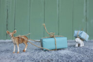 Toy deer transporting Christmas present - GISF00402