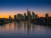 Germany, Hesse, Frankfurt, Skyline of financial district, Main river and Deutschherrn Bridge at sunset - AMF06810