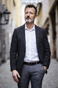 Portrait of mature businessman with greying beard in the city - DIGF06020