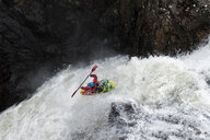 Man kayaking on waterfall on river - ALRF01433