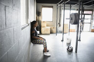 Woman doing wall squats at gym - HEROF27189