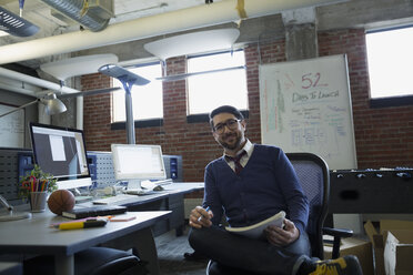 Portrait confident entrepreneur in office - HEROF27285