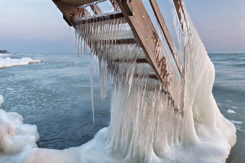 Switzerland, Thurgau, Lake Constance, Kesswil, icicles on the stairs of an old bath house and lake shore at sunrise - SH02088