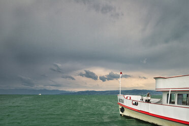 Germany, Baden-Wuerttemberg, Lake Constance, Langenargen, ship at pier and thunderclouds - SH02121