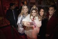 Bachelorette and friends taking selfie in nightclub - HEROF27387