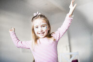 Portrait of smiling little girl made up as butterfly - KMKF00793