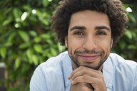 Close up portrait smiling man curly hair stubble - HEROF27626
