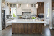 Pendant lights over modern white kitchen island - HEROF27871