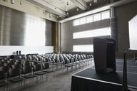 Podium on stage in empty auditorium - HEROF27874