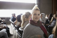Portrait confident woman with blonde mohawk auditorium audience - HEROF27883