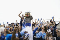 Enthusiastic fan in blue with bulldog mascot bleachers - HEROF27943