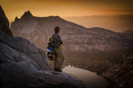 Climber enjoying view on peak, Tuolumne Meadows, Yosemite National Park, California, United States - ISF20967