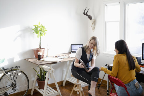 Women with digital tablet working in home office - HEROF27994