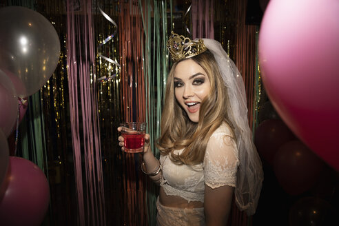 Portrait confident bachelorette drinking cocktail at party - HEROF28033