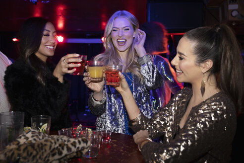 Young women friends toasting cocktails in nightclub - HEROF28057