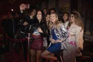 Bachelorette and friends taking selfie in nightclub queue - HEROF28075
