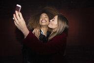 Playful, affectionate women friends taking selfie - HEROF28084
