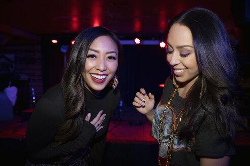 Portrait laughing women friends in nightclub - HEROF28108