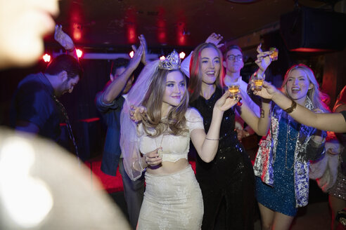 Bachelorette and friends dancing and drinking in nightclub - HEROF28120