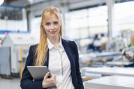 Portrait of confident businesswoman with tablet in factory - DIGF06143