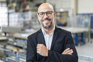 Portrait of smiling businessman in factory - DIGF06158