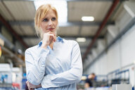 Portrait of businesswoman in factory thinking - DIGF06176