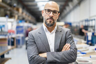 Portrait of confident businessman in factory - DIGF06179