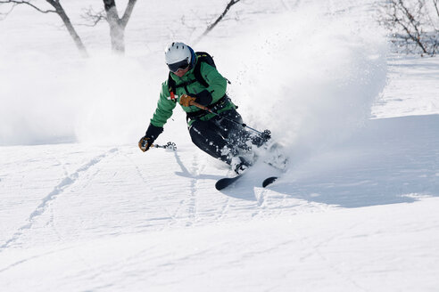 Male skier swerve skiing down mountain, Alpe-d'Huez, Rhone-Alpes, France - CUF49685