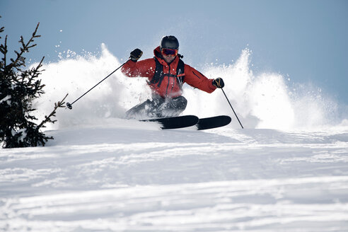 Male skier swerve skiing down mountain, Alpe-d'Huez, Rhone-Alpes, France - CUF49688