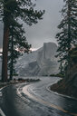 Empty winding road against mountain at Yosemite National Park - CAVF63135