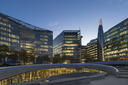UK, London, modern office buildings at dusk - MKF00448