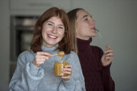 Two best friends tasting honey in the kitchen - LBF02419
