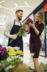 Florist advising customer in flower shop - ZEDF02007